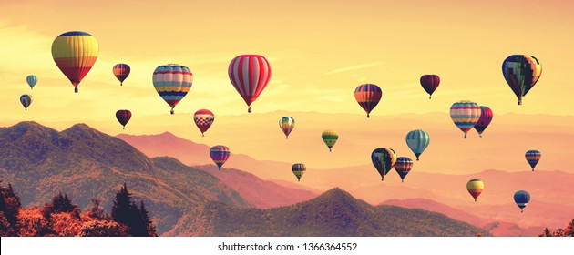 Abstract blurred of Hot air balloon above high mountain at sunset