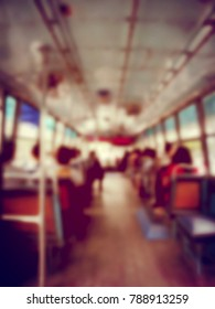 Abstract blurred image background of people on the bus at the morning in Thailand. view from inside with passengers of Bangkok. vintage and film tone effect.