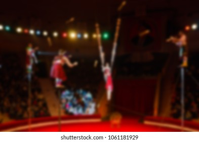 Abstract blurred image of circus performance. Group jugglers on arena in defocus, background