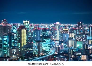 Abstract blurred image of city with bokeh lights at night. Osaka, Japan.