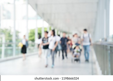 Abstract Blurred image of the Crowd is walking to work in the economy of the country.