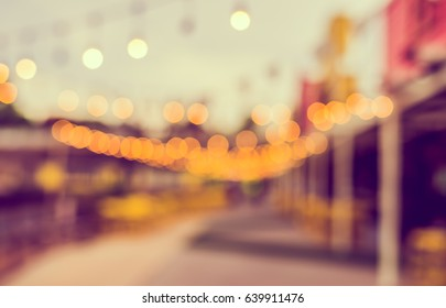 Abstract Blurred image of Day festival with bokeh for background usage . (vintage tone)