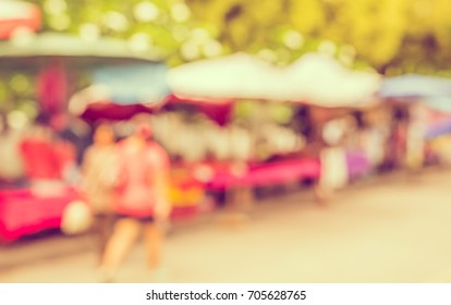 Abstract Blurred image of day market on street  with bokeh for background usage . (vintage tone)