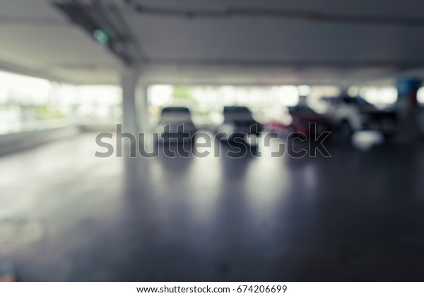 Abstract blurred Image of indoor car park for background usage