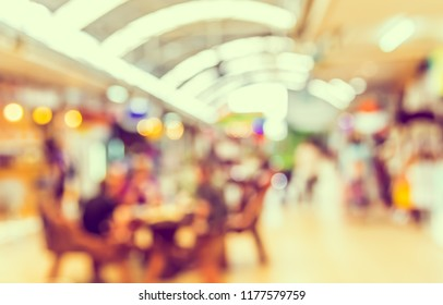 Abstract blurred image  of Indoor day market  with bokeh for background usage. (vintage tone)