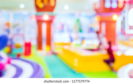 abstract blurred image  of Indoor playground for kid with bokeh for background usage. (vintage tone)