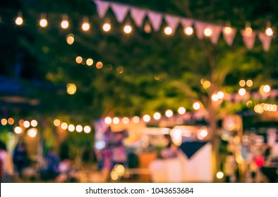 Abstract Blurred image of Night  Festival in garden with bokeh for background usage. (vintage tone)