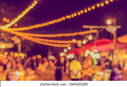 Abstract Blurred image of Night Festival on street  with light bokeh for background usage. (vintage tone)
