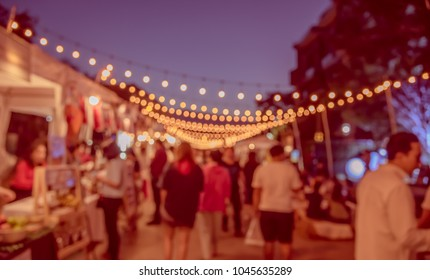 Abstract Blurred image of Night Festival on street  with light bokeh for background usage.