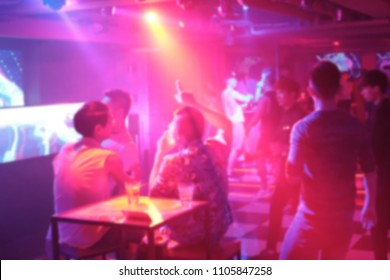 Abstract and blurred image of people drinking and dancing in the night club, photoed in Taipei