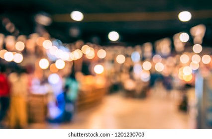 Abstract Blurred image of People at Food Court with bokeh  for background usage. (vintage tone)