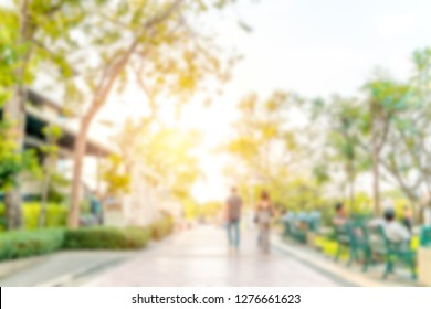 Abstract blurred image of people are relaxing at the park. Bangkok, Thailand.