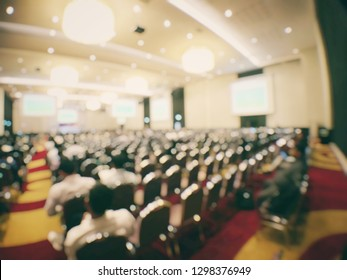 Abstract blurred image of people in seminar room or conference hall for profession seminar and the speaker is presenting new technology with the content activity. education and business concept