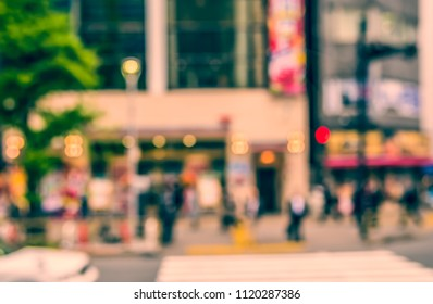 Abstract Blurred image of People walking at footpath on day time with bokeh for background usage .(vintage tone)