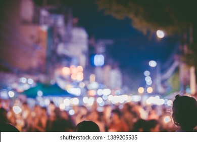Abstract Blurred image of  people walking in the street at night,bokeh at Walking Street Market,Bokeh background and many people