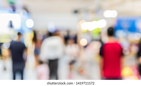 Abstract blurred image of People walking at Shopping mall with bokeh  for background usage.