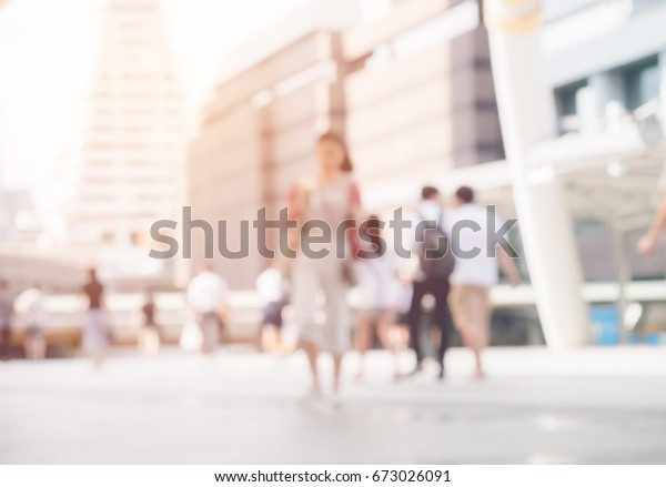 Abstract blurred of image people walking on a street