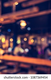Abstract Blurred image of Restaurant  or Coffee shop in Night time with bokeh for background usage . (vintage tone)