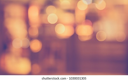 Abstract Blurred image of  Restaurant in night time with bokeh for background usage . (vintage tone)