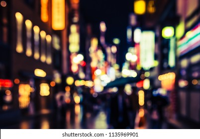 Abstract Blurred image of Street night market with light bokeh for background usage. (vintage tone)