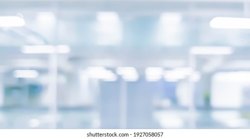 abstract blurred inside interior hospital corridor blue color background with light concept.
