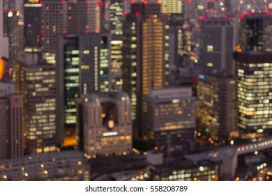 Abstract blurred lights Osaka office building night view, Japan