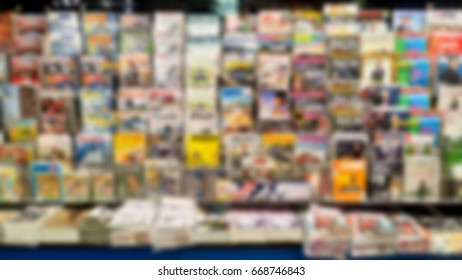 Abstract blurred of magazines on shelf in book store.
