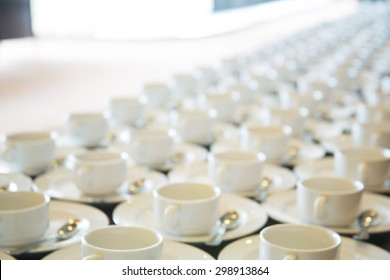 Abstract blurred of many rows of coffee or tea cups for background.