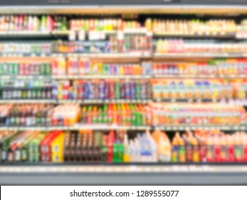 Abstract blurred modern retail supermarket aisle shelves chilled zone
