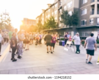 Abstract blurred multiethnic group of runners at sport event at sunrise. Defocused participants of  all abilities at 5K Corporate Challenge race in Richardson, Texas, USA, athletes warm up ready run
