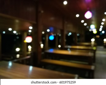 Abstract blurred at night Thai restaurant wooden background