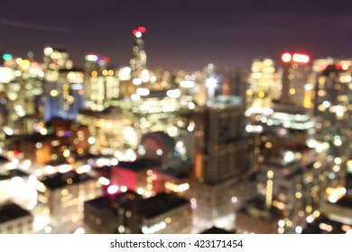 Abstract blurred out of focus city lights background at night, downtown Toronto