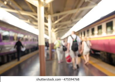 Abstract blurred of passengers walking on walkway at railway station use for the background.