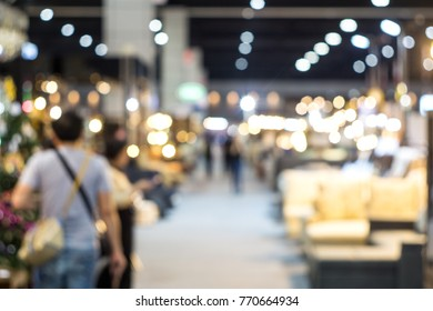 Abstract blurred people in exhibition hall event for background.