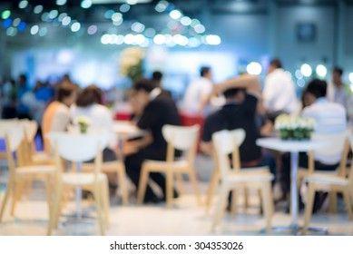 abstract blurred people in food center and coffee shop