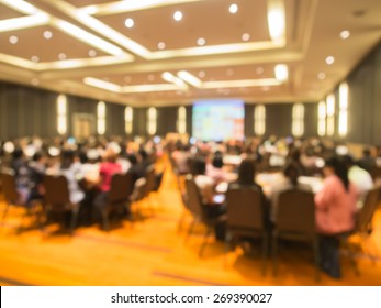 Abstract blurred  people in  meeting or conference room for background. Warm tone photo.