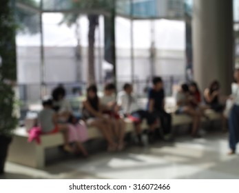 Abstract blurred people relax after shopping in department store