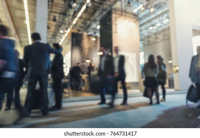 Abstract blurred people in a trade show hall event background usage