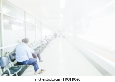 Abstract blurred people waiting in corridor hospital interior background with defocused effect