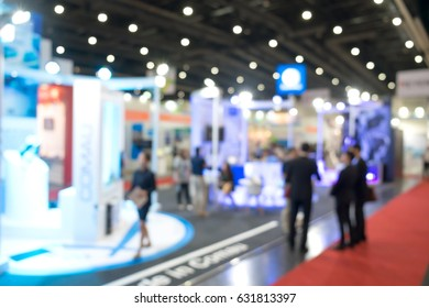 Abstract blurred people walking in exhibition hall event background