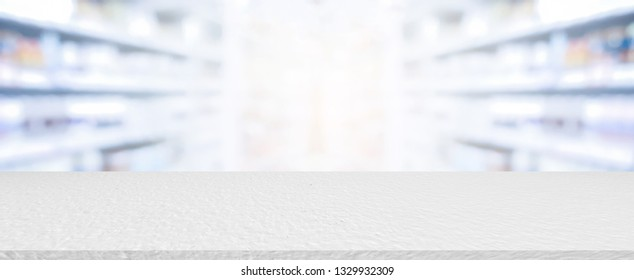abstract blurred pharmacy drug store interior with white cement countertop perspective plank background for promote or advertise producs and goods  on display concpt
