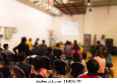Abstract blurred photo background of business people in conference hall or seminar room. Bokeh business meeting conference training learning coaching concept.