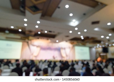 Abstract blurred photo background of business people in conference hall or seminar room. Defocused people in meeting room concept.