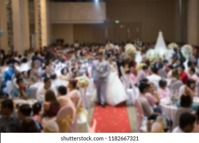 Abstract blurred photo of conference hall or seminar room in Exhibition Center with speakers on the stage