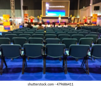 Abstract blurred photo of conference hall or seminar room background