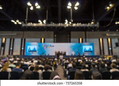 Abstract blurred photo of conference hall or seminar room with Speakers on the stage and attendee background, business and education concept