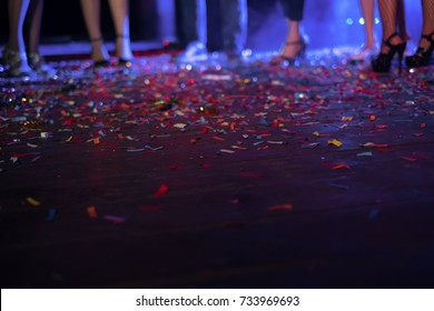 Abstract blurred photo of confetti falling on the floor after celebrating party make colorful background, party concept. Selective focus blurred background. party,celebration, nightlife concept .