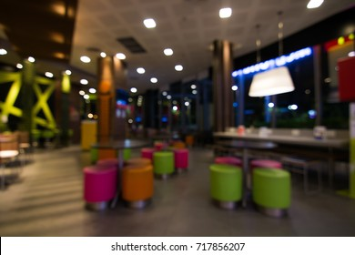Abstract blurred photo of  counter bar, tables and chairs in a fast food restaurant