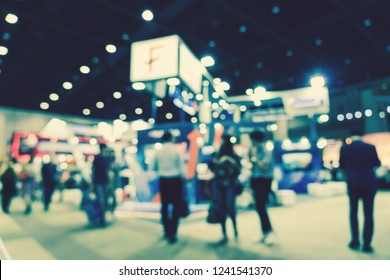 Abstract blurred photo of financial exhibition event in conference hall background, business trade and stock market exchange concept