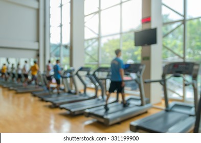 Abstract blurred photo of fitness gym background